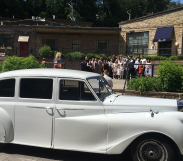 rolls royce limo rolls up to a wedding