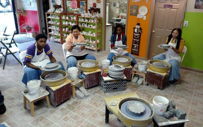 teens making pottery