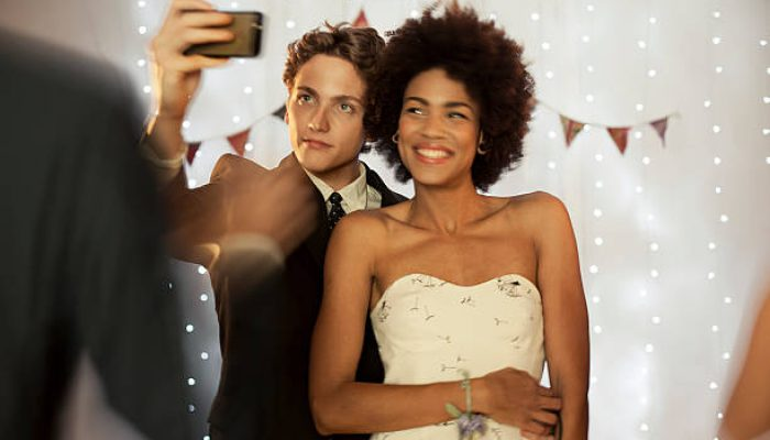 a girl and guy taking a selfie at prom